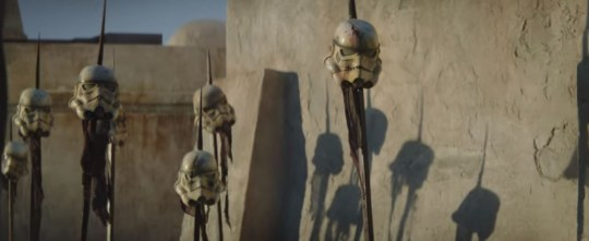 Stormtrooper helmets on spikes in The Mandalorian