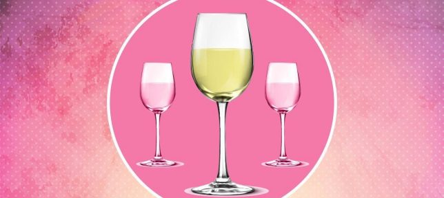 Three wine glasses filled with wine (white and rose) on a pink background