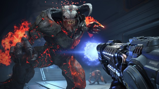 A Fire Baron from DOOM Eternal is about to get shot by a sci-fui gun