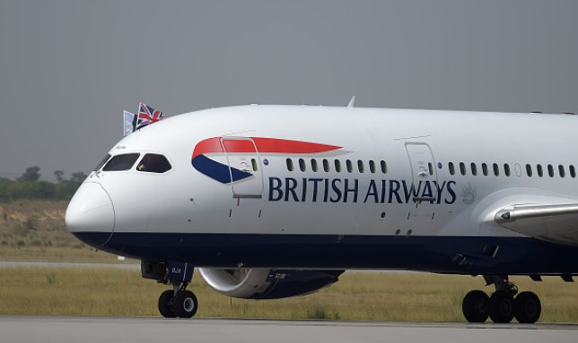 A British Airways plane on a runway at an airport