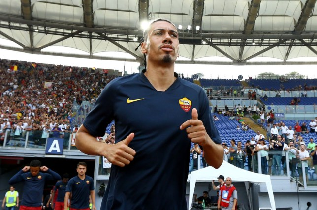 Chris Smalling jogs out to warm up before Roma's game against Lazio