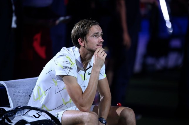 Daniil Medvedev sits at the side of the court after his US Open defeat
