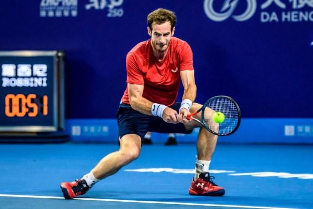 Andy Murray hits a backhand against Alex de Minaur in Zhuhai