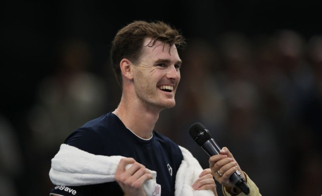 Jamie Murray smiles as he gives a speech at the Murray Trophy