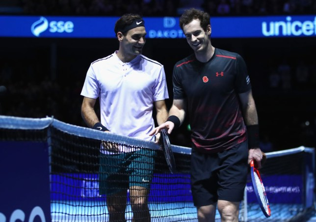 Roger Federer and Andy Murray smile together after a charity match
