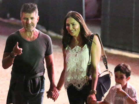 Simon Cowell is a big kid as he tests out carnival rides with Eric and Lauren Silverman at Malibu fair