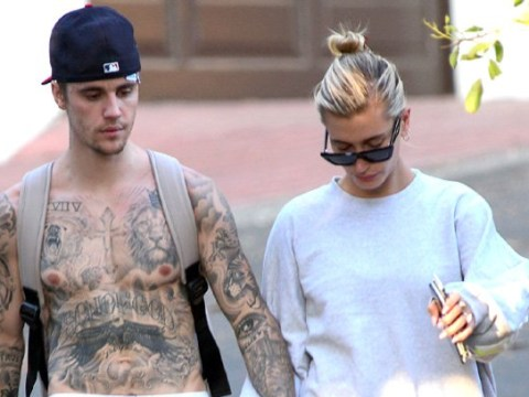 Justin Bieber shows off extensive tattoo collection as he soaks up sun with Hailey Baldwin