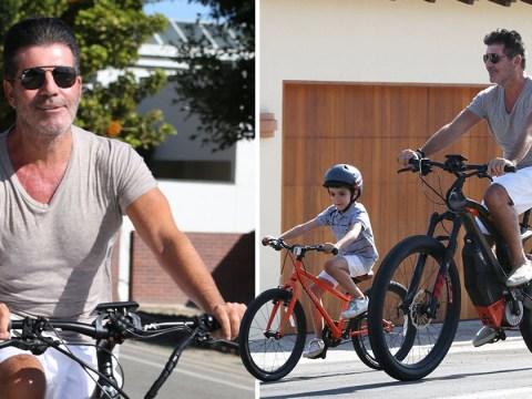 Simon Cowell enjoys relaxing bike ride with mini-me son Eric in the Malibu sunshine