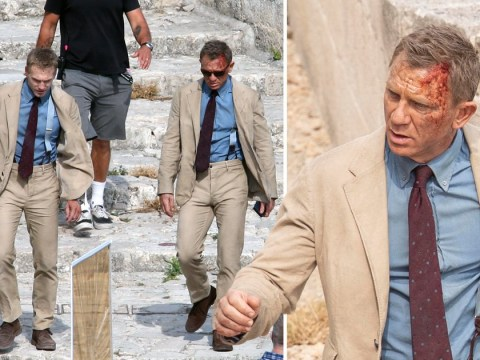 Daniel Craig's face covered in blood as he laughs with body double in No Time To Die