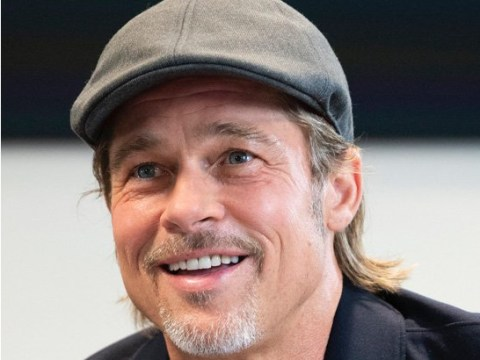 Brad Pitt wants to know if he's a better astronaut than George Clooney as he chats with actual spaceman