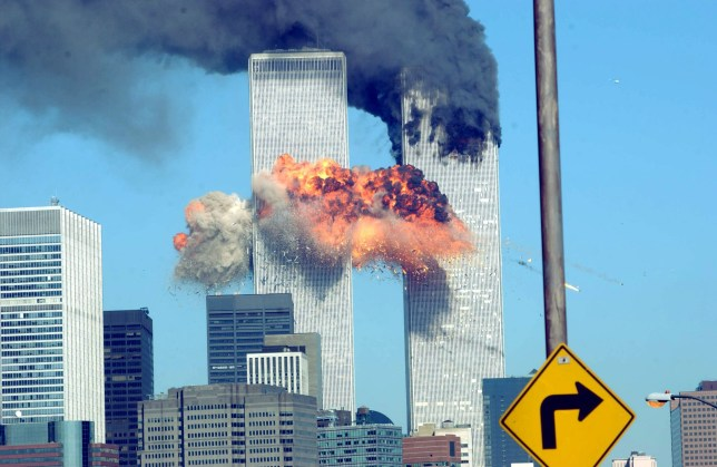 A fiery blasts rocks the World Trade Center after being hit by two planes September 11, 2001 in New York City