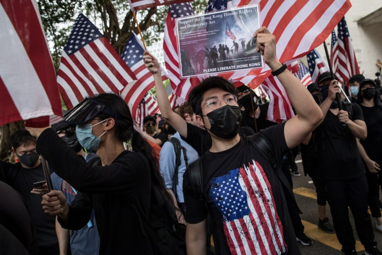 Hong Kong protesters in US flags ask Donald Trump to
