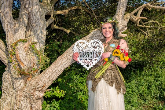 A woman who has married a tree in a ceremony at a Merseyside park says she has a serious reason for her wedding vows. Kate Cunningham, 34, from Melling, Liverpool, tied the knot at Rimrose Valley Park in Litherland as family and friends watched on. Credit: Liverpool Echo/Geoff Davies