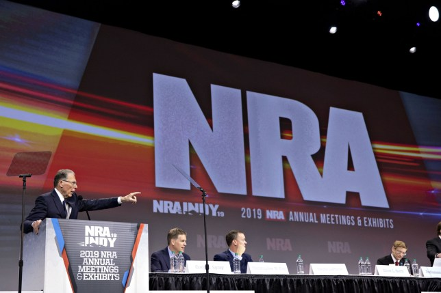 Wayne LaPierre, chief executive officer of the National Rifle Association (NRA), left, speaks during the NRA annual meeting of members in Indianapolis, Indiana, U.S., on Saturday, April 27, 2019. Retired U.S. Marine Corps Lieutenant Colonel Oliver North has announced that he will not serve a second term as the president of the National Rifle Association amid inner turmoil in the gun-rights group. Photographer: Daniel Acker/Bloomberg via Getty Images