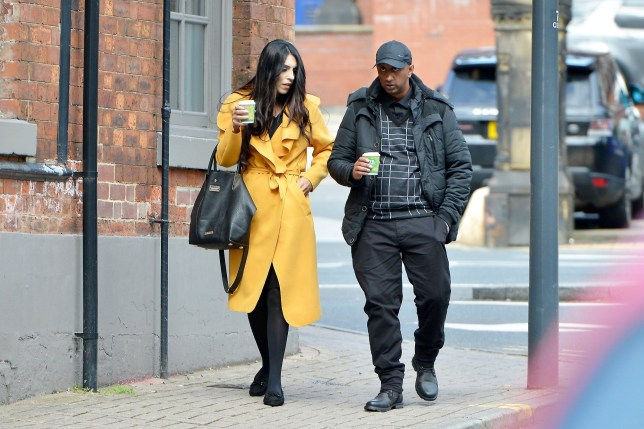Fehreen Rafiq (left, in yellow) and Mohammed Sajid (right) arrive at Leeds Crown Court to face charges relating to sexual misconduct with young girls, West Yorks., September 10 2019. They appear with several co-defendants. See SWNS story SWLEgroom.