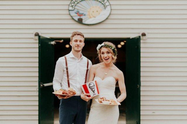 couple holding KFC on their wedding day
