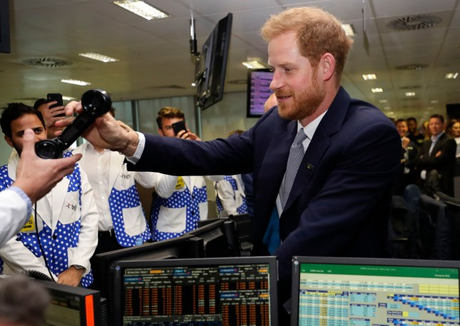 The Duke of Sussex is handed a phone during the 15th BGC annual charity day at Canary Wharf in London, in commemoration of BGC's 658 colleagues and the 61 Eurobrokers employees lost on 9/11. PRESS ASSOCIATION Photo. Picture date: Wednesday September 11, 2019. See PA story ROYAL Sussex. Photo credit should read: Kirsty Wigglesworth/PA Wire