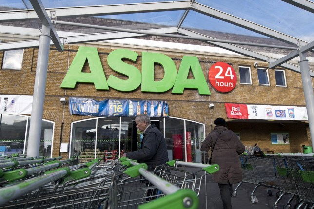Customers arrive to go shopping at a branch of Asda supermarket in south London, on January 10, 2018. / AFP PHOTO / Justin TALLIS (Photo credit should read JUSTIN TALLIS/AFP/Getty Images)