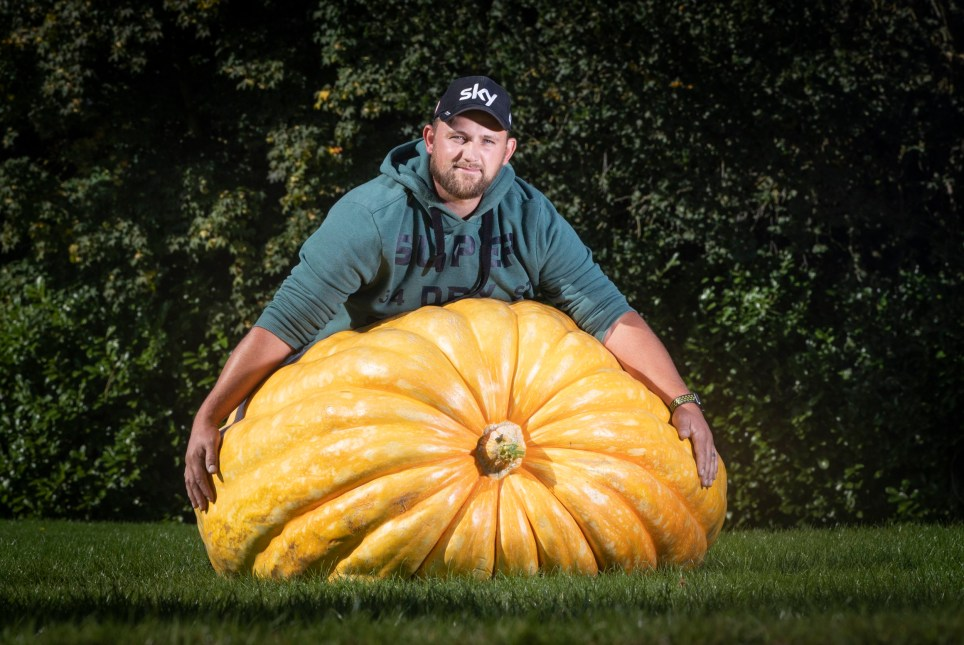 Richard Mann with his winning giant pumpkin weighing 291.7 kilos, the scooped 1st prize in the pumpkin category of Giant Vegetable competition at the Harrogate Autumn Flower Show in Yorkshire. PA Photo. Picture date: Friday September 13, 2019. Staged at the Great Yorkshire Showground the Harrogate Flower Show is Britain's premier autumn gardening event. The show features over 5,000 beautiful autumn blooms in Britain's biggest exhibition by specialist gardening groups and a world-famous giant vegetable competition. Photo credit should read: Danny Lawson/PA Wire