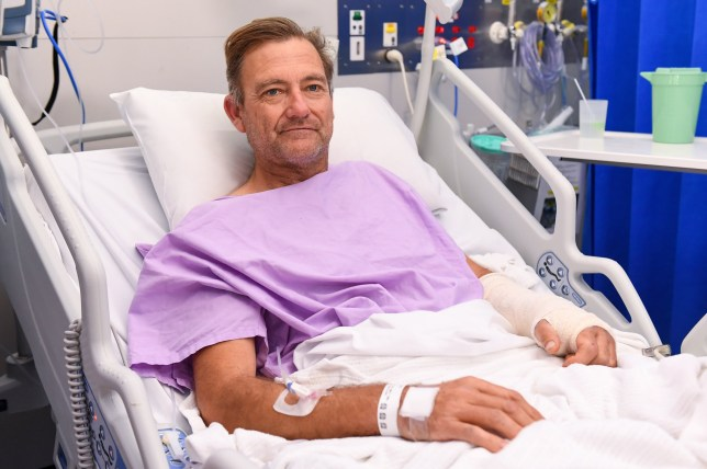 epa07849953 Bushwalker Neil Parker poses for a photograph at Princess Alexandra Hospital in Brisbane, Australia, 18 September 2019. Neil Parker, 54, fractured his leg and wrist in the six-metre fall on 15 September while walking by himself in Cabbage Tree Creek on Mount Nebo, northwest of Brisbane. EPA/ALBERT PEREZ AUSTRALIA AND NEW ZEALAND OUT