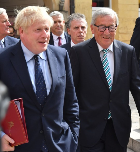 Boris Johnson, U.K. prime minister, center left, and Jean-Claude Juncker, president of the European Commission, depart following Brexit talks at a restaurant in Luxembourg, on Monday, Sept. 16, 2019. Boris Johnson held his first face-to-face talks with European Commission President Jean-Claude Juncker over a working lunch of snails, salmon and cheese in Luxembourg. Photographer: Geert Vanden Wijngaert/Bloomberg via Getty Images