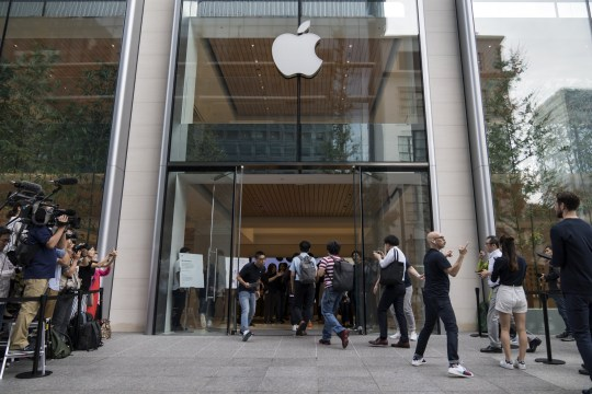 Apple fans gather outside an Apple Store in Tokyo (Photo by Tomohiro Ohsumi/Getty Images)