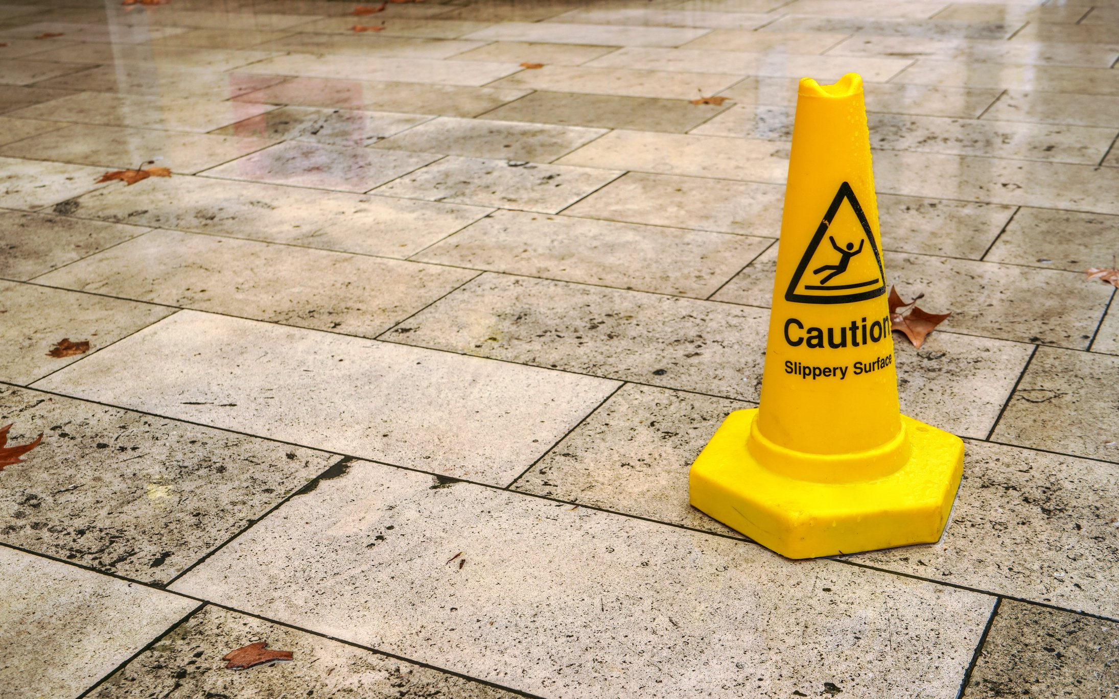 Yellow cone with counsel sleazy aspect sign, on soppy cement tiles..