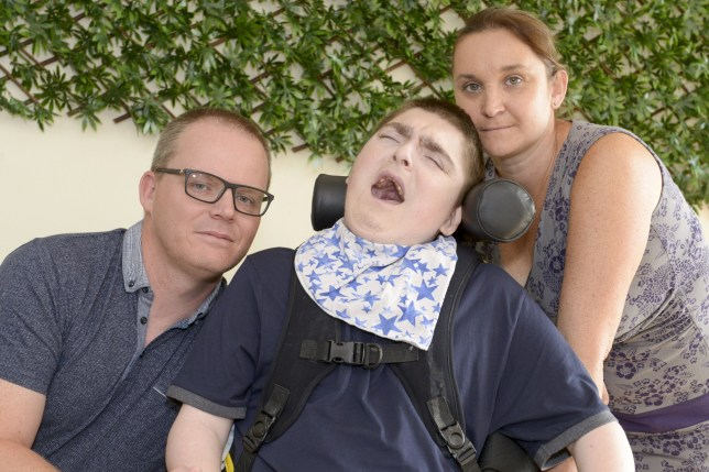 Lee amd Joanne Faulkner with son Aaron who has had to attend a fit for work interview despite having cerebral palsy and a rare condition called unbalanced chromosome translocation. See SWNS story SWLEcredit. He cannot walk, talk or control his arms and is fed by a tube ? but officials still made Doncaster teenager Aaron Faulkner travel 25 miles for a fitness to work interview. Devoted Doncaster mum Joanne Faulkner has spent the last 19 years taking care of her disabled son's every need because Aaron, of Kirk Sandall, suffers from a rare condition called unbalanced chromosome translocation. It means he is wheelchair-bound, also suffering cerebral palsy and breathing problems. He cannot speak or communicate at all, cannot control his arms, and is fed through a tube in his stomach. Yet his mum and dad were left flabbergasted when officials from the Department for Work and Pensions insisted he had to travel into Doncaster Jobcentre for a fitness for work interview for Universal Credit.