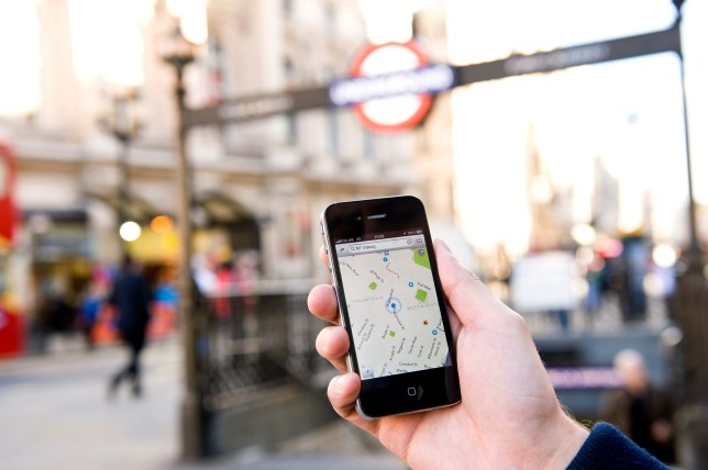 A man using Google Maps on an iPhone to find his way around London, October 4, 2012. (Photo by Kevin Nixon/Future via Getty Images)