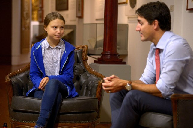 Canada's Prime Minister Justin Trudeau greets Swedish climate change teen activist Greta Thunberg before a climate strike march in Montreal, Quebec, Canada September 27, 2019. REUTERS/Andrej Ivanov
