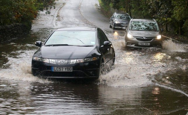 Following overnight torrential rain, roads in the North West have flooded in many places. Cars battle through the flood water on Belmont Road on the outskirts of Bolton. September 29, 2019.