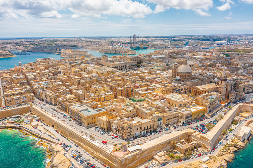 Aerial panoramic cityscape view of Lady of Mount Carmel church, St.Paul's Cathedral in Valletta city center, Malta