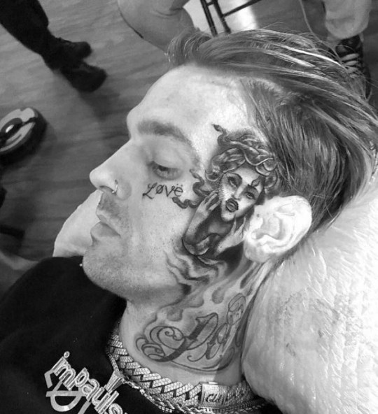 Aaron Carter tattoo artist cut him off from getting whole ...