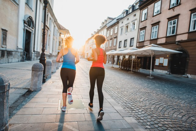 Two women running in the morning in the city
