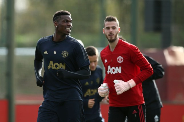 Paul Pogba and David De Gea joking in Manchester United training
