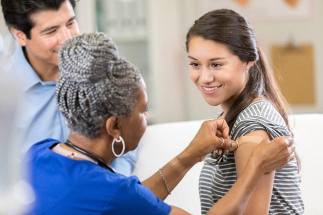 Nurse places bandage on female patient