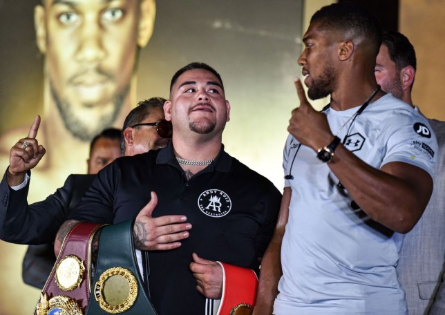 "Mexican-American heavyweight boxing champion Andy Ruiz Jr (L) and British boxing challenger Anthony Joshua (R) pose together during a press conference ahead of the upcoming ""Clash on the Dunes"" fight between Ruiz Jr and Joshua in December, in Diriya on the western outskirts of the Saudi capital Riyadh on September 4, 2019. - The ""Clash on the Dunes"" is scheduled to take place in Diriya on December 7. (Photo by Fayez Nureldine / AFP) (Photo credit should read FAYEZ NURELDINE/AFP/Getty Images)"