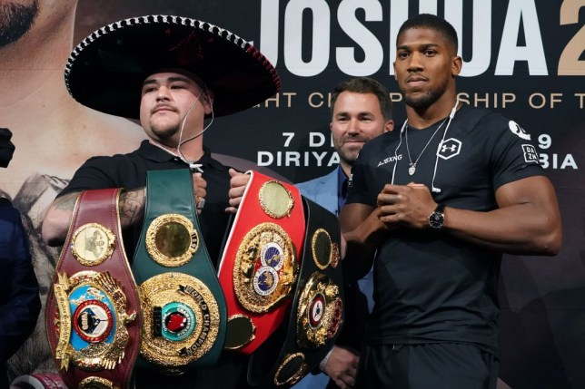 Anthony Joshua and Andy Ruiz Jr pose for pictures with the heavyweight titles at a press conference