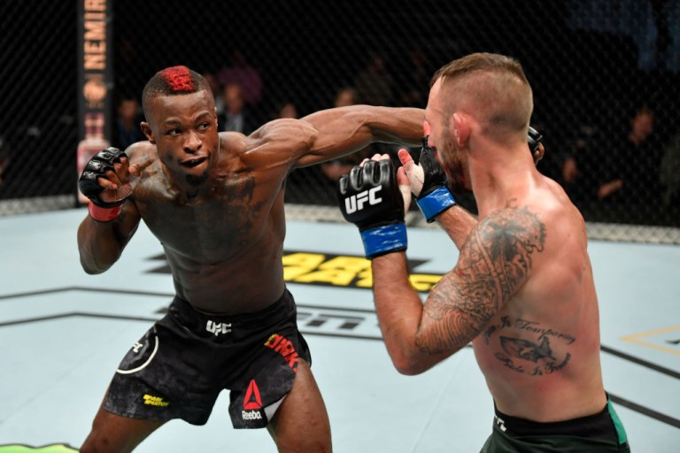 COPENHAGEN, DENMARK - SEPTEMBER 28: (L-R) Marc Diakiese of England punches Lando Vannata in their lightweight bout during the UFC Fight Night event at Royal Arena on September 28, 2019 in Copenhagen, Denmark. (Photo by Jeff Bottari/Zuffa LLC/Zuffa LLC via Getty Images)