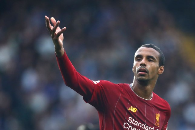 Joel Matip issues instructions during Liverpool's win against Chelsea
