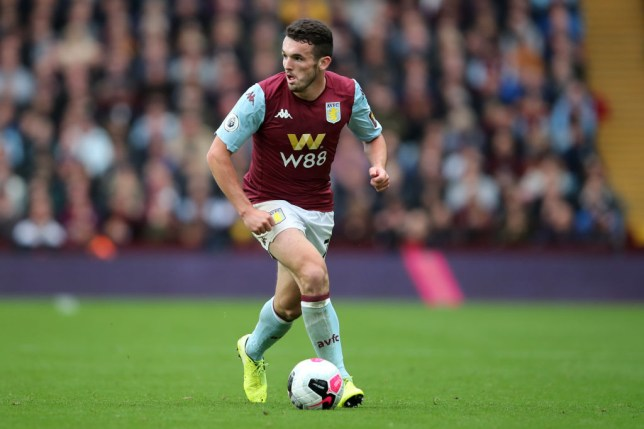 Manchester United target John McGinn carries the ball while playing for Aston Villa