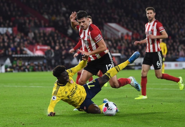 Ian Wright feels Mike Dean was right to book Bukayo Saka in Arsenal's defeat at Sheffield United