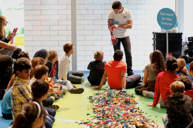 Kids at a Rebuilder workshop in Denmark, with David Aguilar - who built his own prosthetic Lego arm