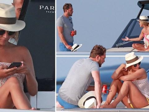Caroline Flack looks tense in heated chat with boyfriend Lewis Burton on luxury Ibiza holiday