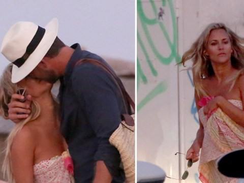 Caroline Flack and boyfriend Lewis Burton share a romantic kiss after putting intense fight behind them
