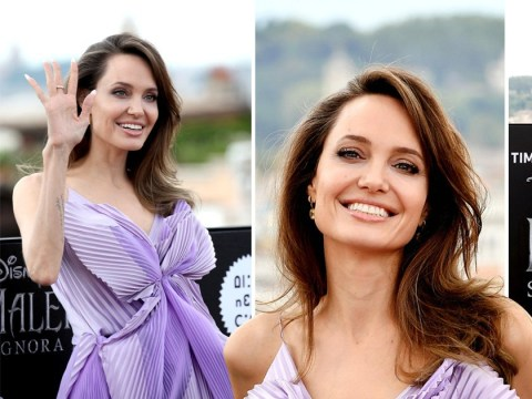 Angelina Jolie is a goddess as she radiates happiness at Maleficent photocall