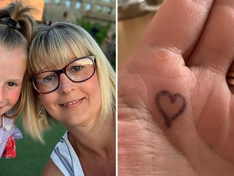 Mum draws hug button on anxious daughter's hand to stop her crying at school gates