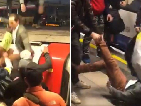 Angry commuters drag XR protesters off top of Tube train and attack them on platform