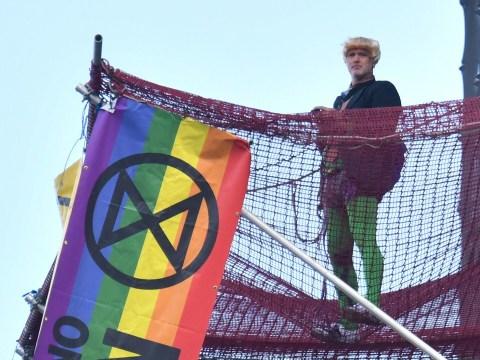 Extinction Rebellion protester dressed as Boris Johnson climbs Big Ben