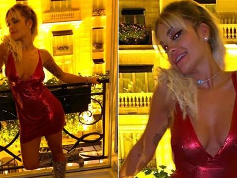 Rita Ora is feeling herself in scarlet mini-dress as she begins filming as Dodge in Oliver remake